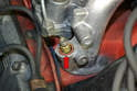 Insert the new injector, O-rings and sleeve into the runner (red arrow).