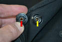 As the caps age the small clips inside (yellow arrow) will begin to fail and eventually leave the cap loose and the cover flapping around in the wind.