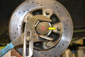 Once the calipers and pads are removed, you'll have access to the wheel bearing hub.