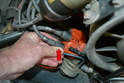 The same holds true for removing them from the distributor cap; always grab the connector by the base (red arrow) and never pull by the wire or use some tool to try and remove them.