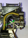 When the lever is pushed forward, the center contact is toggled downward against the lower contact (white wire).