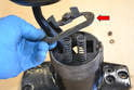 With the nuts removed you can remove the top plate (red arrow).