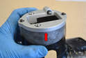 The WEVO top plate must sit completely flush with the top of the housing so trial fit this first and file down any imperfections in the housing that might cause any small gaps between the housing the plate (red arrow).