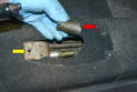 Remove the socket from the tube (red arrow) and slide the L-shaped bracket forward off the tube (yellow arrow).