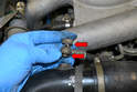 If you are removing the lid completely, it is easier to disconnect the line running to the turbo pipe with a 17mm wrench.
