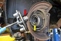 Either way you remove the flange the inner race of the bearing (red arrow) will more than likely come off with the wheel flange leaving the ball bearings in the bearing exposed (yellow arrow).