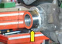 Depending on the condition of the vehicle, the bearing will either slip right in or just to the beginning edge (yellow arrow).