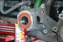 Press the bearing in until it is fully seated and flush with the flange on the hub (red arrow).