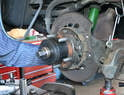 Use a bearing tool to press the hub into the new bearing.