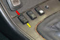 To open the sunroof turn the ignition switch to the ON position and press the switch down toward the rear of the car (yellow arrow).