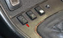 To remove the sunroof turn the ignition switch to the off position and press the down switch towards the rear of the car (red arrow) to retract the lifting arms.