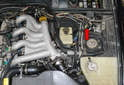 The clutch master cylinder is located just to the right of the brake booster and under a bunch of EVAP hoses (red arrow).