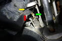 With the cover removed you can see where the rod for the master cylinder (green arrow) connects to the clutch pedal shaft (red arrow).