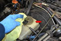 Before you begin clean the area around the cap (red arrow).