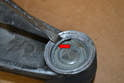 Use a flathead screwdriver and pry the retaining ring out (red arrow).