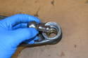 Insert the ball joint pin into the control arm and upper bushing.