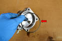 Remove the large gasket from the base and replace it with the appropriate gasket from the kit (red arrow).