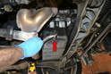 Place a large catch pan or bucket below the drain plug on the lower right side of the engine.
