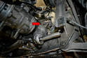 Place alignment marks on the splined input shaft on the steering rack and the universal joint on the steering shaft so they can be assembled in the same orientation on installation (red arrow).