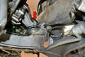 Remove the bolts on the top of the motor mounts (red arrow).