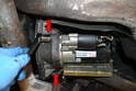Remove the starter motor; please see our article on starter motor removal for additional assistance.