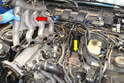 Next you will need to remove the intake manifold (red arrow) to give you access to the turbo and outlet pipe below (yellow arrow).