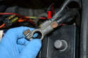 Check the straps for corrosion (red arrow) and clean or replace as needed.