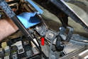 Wiggle and pull the wiper arm off the base (red arrow).