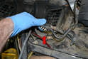 Follow the wiring from the motor and disconnect it from the connection next to the base of the blower motor housing (red arrow).