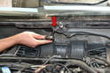 Remove the 10mm nut under the center arm base (red arrow).