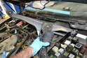 Remove the motor and arm assembly from the vehicle and take it to your workbench.