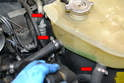 There are three lines that attach to the fluid expansion tank (red arrows) plus the overflow line by the cap.