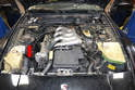 The coil is located in the front right side of the engine compartment just to the right of the distributor and behind the headlight motor (red arrow).