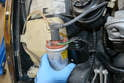Slide the coil up between the motor and reservoir, using care so as not to damage the wires.