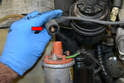 Remove the plug to the distributor and check its condition.