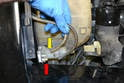 Windshield Pump- Remove the fluid lines from the pump (yellow arrow) using care, as the plastic nipples on the pump get very brittle over time and can break off in the lines (red arrow).
