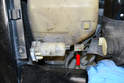 Windshield Pump- Disconnect the electrical connection (red arrow).