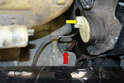Headlight Pump- The headlight pump (red arrow) is down in the lower section of the reservoir below the headlight motor (yellow arrow).