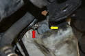 Headlight Pump- If the pump is really stuck you may need to get under the vehicle and help push the pump up with a flathead screwdriver (yellow arrow).