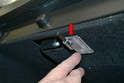 Use a trim removal tool and gently pry the light down from the glove box (red arrow).