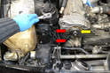 Use a 10mm socket and remove the two bolts holding the right side of the crossover pipe to the frame rail (red arrows).