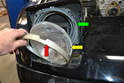 With the screws removed the trim ring (red arrow) and light (yellow arrow) will probably fall forward from the mounting assembly (green arrow), so be prepared.