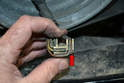 Carefully check the condition of the wiring and connectors (red arrow).