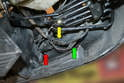 With the brake air duct gone you can see the wiring for the side running lights (green arrow), the fog lights (yellow arrow) and the turn signal (red arrow).