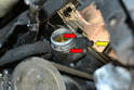 Under Vehicle- Use a flathead screwdriver and separate the hose from the additional thermostat housing (yellow arrow).