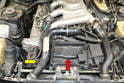Above Vehicle- The additional thermostat is located on the right front of the motor on the coolant pump.