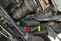 There is a cooling tube from the left front of the vehicle to the rear of the alternator (red arrow).