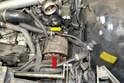 Disconnect the hose to the electrical coolant pump (yellow arrow).