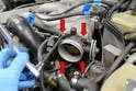 Us a 5mm Allen and remove the four bolts holding the throttle body to the intake manifold (red arrows).