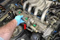 You will need to first remove the fuel rail and injectors (red arrow).